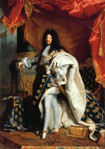 Portrait of Louis XIV of France, painted in 1701 by Hyacinthe Rigaude. Louis XIV is wearing robes trimmed with ermine and a large, flowing black wig.
